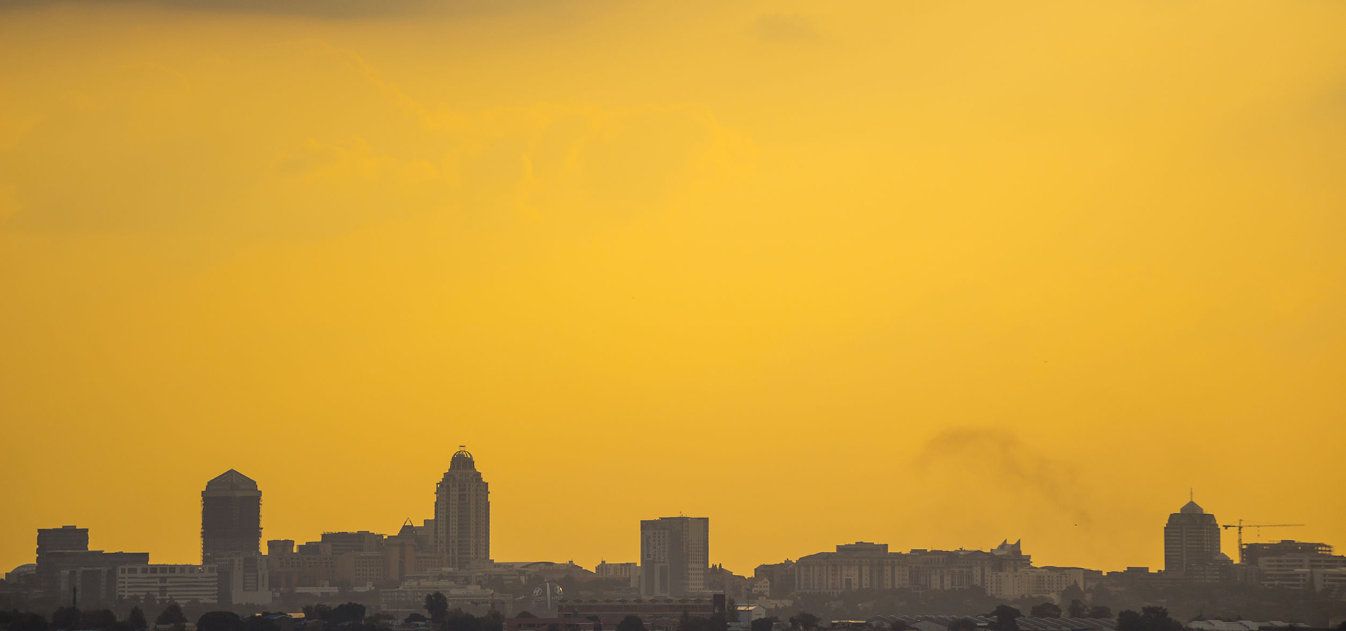 28388189 – sandton skyline, johannesburg during an orange, moody sunset